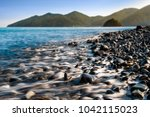 seascape during suunrise with... | Shutterstock . vector #1042115023