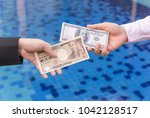 hand hold japanese yen and usd... | Shutterstock . vector #1042128517