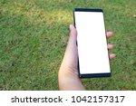 female hand holding the... | Shutterstock . vector #1042157317