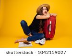 sad woman with a suitcase ... | Shutterstock . vector #1042159027