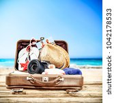 suitcase of brown color and... | Shutterstock . vector #1042178533