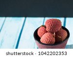 bowl and litchi  | Shutterstock . vector #1042202353