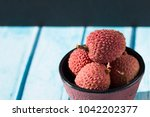bowl and litchi  | Shutterstock . vector #1042202377