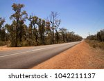 a straight road disappears into ... | Shutterstock . vector #1042211137