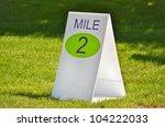 Mile Marker Sign On Grass