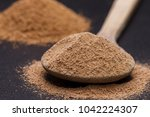 ground up pure cane sugar on a... | Shutterstock . vector #1042224307