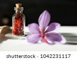 dried saffron spice in a bottle ... | Shutterstock . vector #1042231117