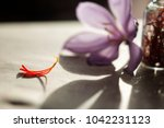 dried saffron spice in a bottle ... | Shutterstock . vector #1042231123