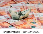 a boat built of hundred dollar...   Shutterstock . vector #1042247023