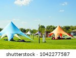 tent awning star  a white tent... | Shutterstock . vector #1042277587