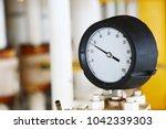 pressure gauge using measure... | Shutterstock . vector #1042339303