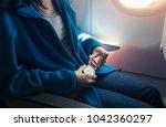 passenger fastening seat belt...   Shutterstock . vector #1042360297