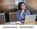 pretty asian women thinking on... | Shutterstock . vector #1042435867