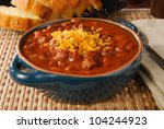 A Bowl Of Hot Chili With Melte...