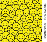 seamless pattern with sad face... | Shutterstock .eps vector #1042468483