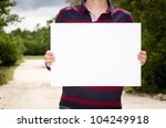 Man holding empty paper in hands - stock photo