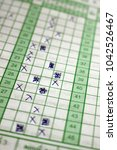 Small photo of Students answer sheet with choices marked with crosses from a multiple choice test paper