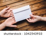 hand pass the white envelope to ... | Shutterstock . vector #1042543933