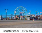 Small photo of CONEY ISLAND, USA - OCT 3, 2017 People visit famous old promenade at Coney Island, the amusement beach zone of New York.