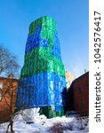 Small photo of Protective cover green blue colour on the building of the Clock Tower. Vyborg. Russia