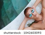 young man in round sunglasses...