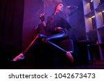 sexy rock star girl smoke...   Shutterstock . vector #1042673473