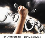 fist smashes the fetters.... | Shutterstock . vector #1042685287