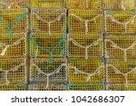 lobster pots in fishing village   Shutterstock . vector #1042686307