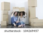 happy young couple moving in...   Shutterstock . vector #104269457
