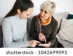a young girl explains to an...   Shutterstock . vector #1042699093