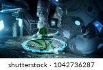 two astronauts analyzing plant... | Shutterstock . vector #1042736287