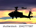 Small photo of Salisbury Plain, Wiltshire, UK - November 22, 2007: AugustaWestland Apache AH.MK1 helicopters of the British Army Air Corps