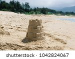 tower of sand on the beach... | Shutterstock . vector #1042824067
