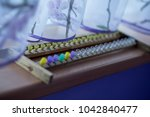 quilted queen bees on the frame.... | Shutterstock . vector #1042840477
