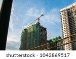 construction crane on top of a...   Shutterstock . vector #1042869517