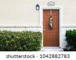 residential doorway with green... | Shutterstock . vector #1042882783