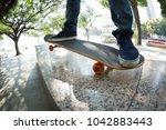 young skateboarder legs riding... | Shutterstock . vector #1042883443