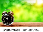 retro clock on wooden  with a... | Shutterstock . vector #1042898953