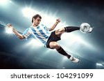 A soccer player with the ball form water - stock photo