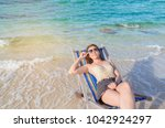 young lady relaxing in a chair... | Shutterstock . vector #1042924297
