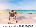 young lady relaxing in a chair... | Shutterstock . vector #1042924387