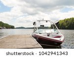 a wakeboard boat at a wooden... | Shutterstock . vector #1042941343