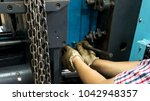 a worker is setting up a steel... | Shutterstock . vector #1042948357