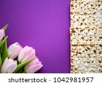 matzah for passover and pink... | Shutterstock . vector #1042981957