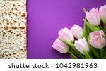matzah for passover and pink... | Shutterstock . vector #1042981963