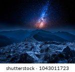 stunning milky way in mountains ... | Shutterstock . vector #1043011723