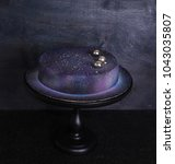 Small photo of chocolate velour mousse cake in galaxy style