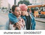 two young women outdoors posing ... | Shutterstock . vector #1043086537