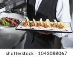 the waiter with the ready... | Shutterstock . vector #1043088067