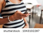 midsection shot of woman...   Shutterstock . vector #1043102287